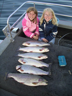 Young girls with big fish
