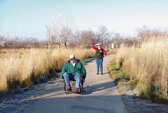 Person in wheelchair enjoys outdoor trail