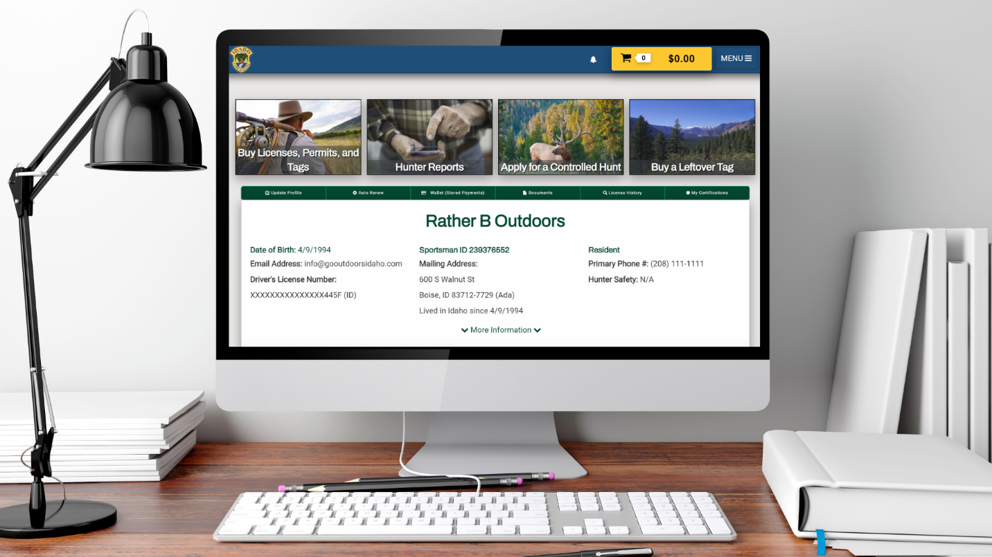 A computer monitor sits on a desk with the GoOutdoorsIdaho.com hunter profile page open on the screen.