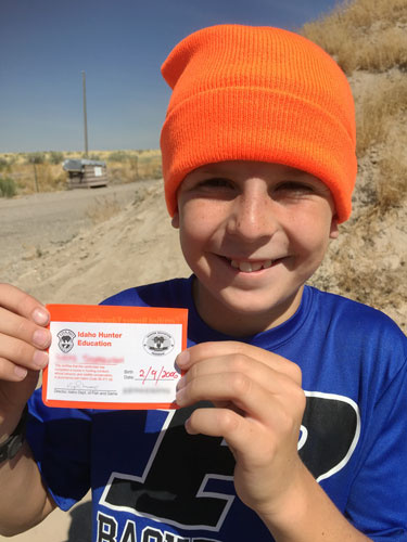 This graduate got an Idaho hunter education card and an orange beanie!