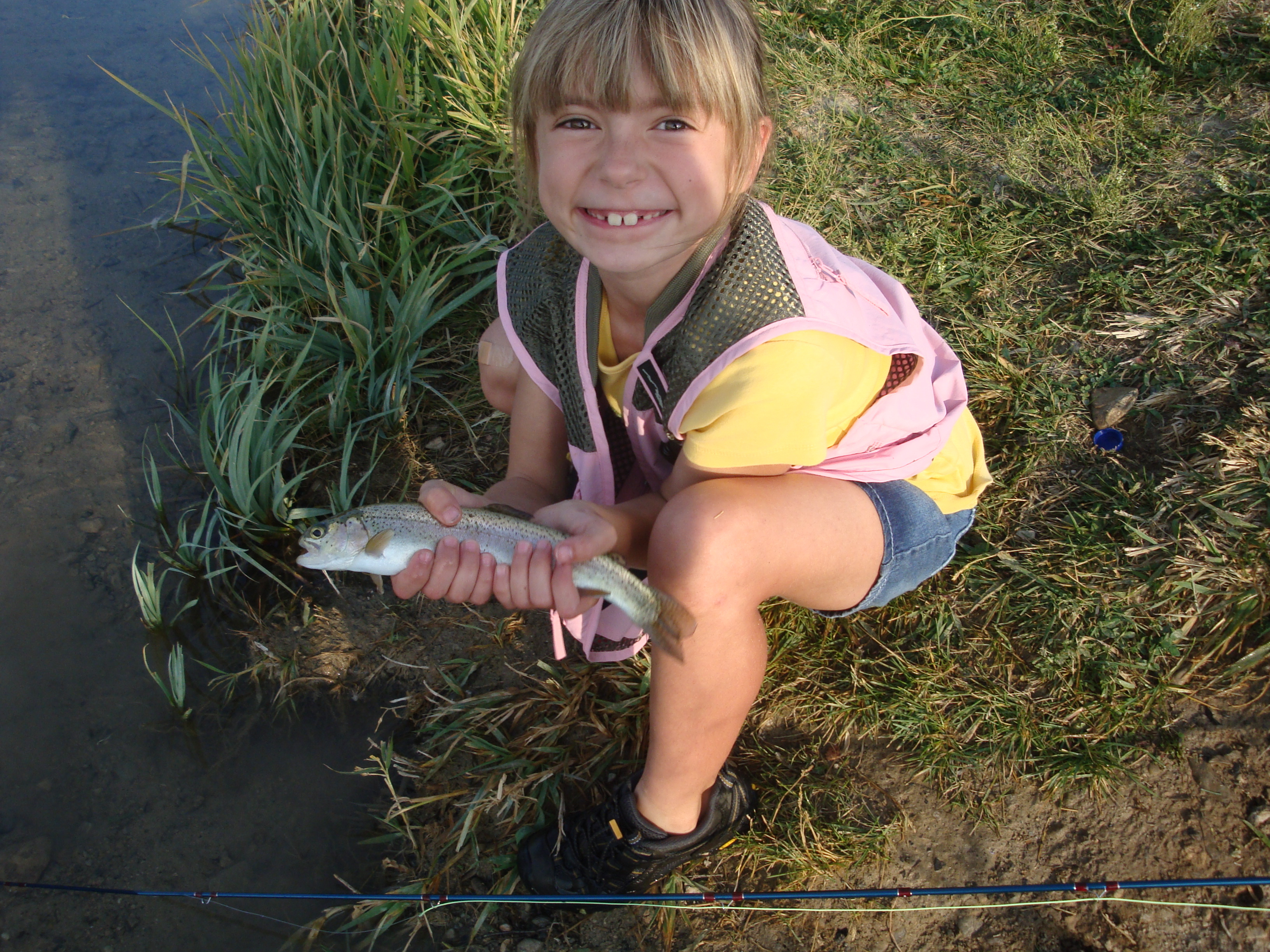Ainsley's first rainbow on a fly rod, fishing in Region 5