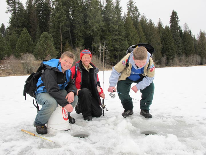 Boy Scouts jigging through the ice for perch