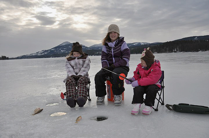 Three sisters dressed for ice fishing on Cocolalla Lake