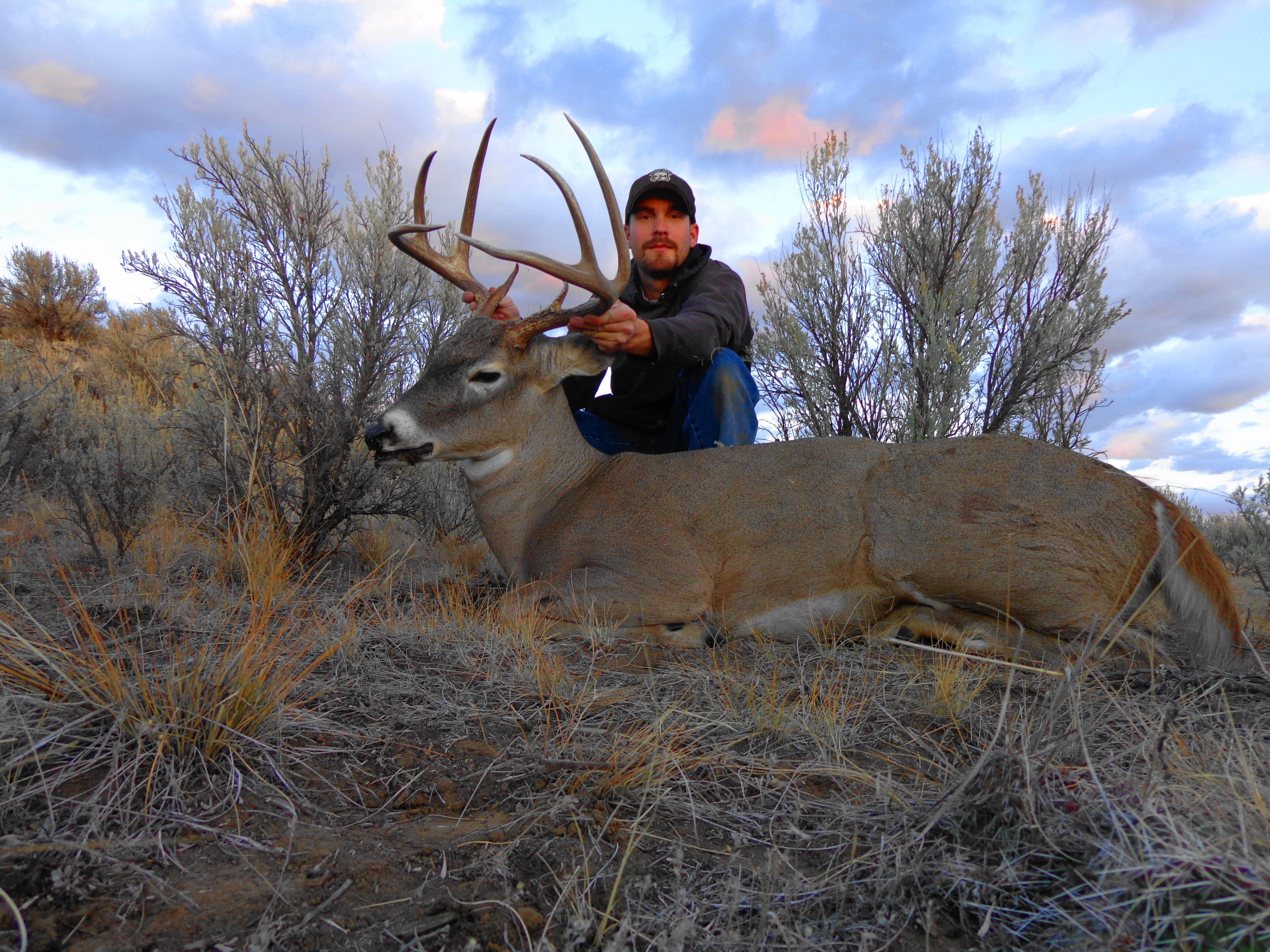 hunter with his whitetail buck October 2012