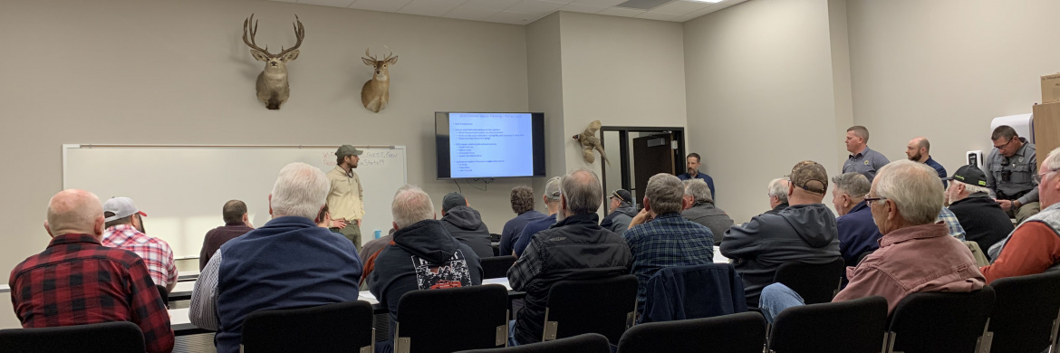 A large group listens at a Chinook public meeting