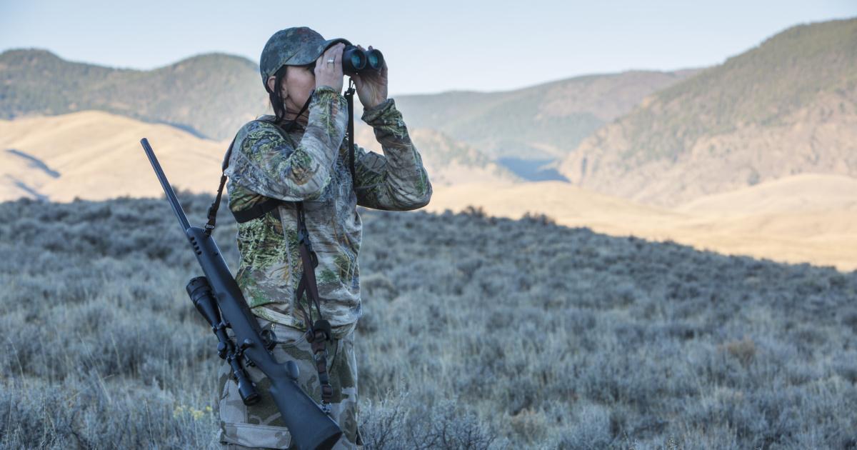 hunter looking in binoculars for her animal Lope hunt October 2015