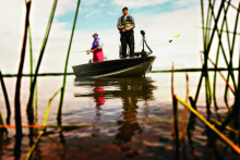 Two anglers bass fishing from boat