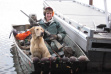 hunter showing off her ducks with a dog in a boat on the Coeurd' alene River November 2010