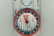 A liquid-filled protractor or orienteering compass with lanyard, public domain by Adrian Pingstone