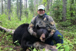 man with his black bear