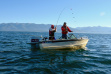 family fishing in a boat for kokanee on Lake Pend Oreille fish on September 2015 medium shot