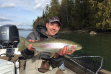 Angler with trout on Clark Fork River