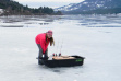 Pink girl, black sled - ice fishing in Panhandle of Idaho