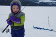 A boy and his firsh fish on the ice