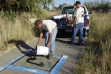Volunteers Ron and Ross Carrico with AMU Inc. cover graffiti at Wilson Ponds in Nampa.