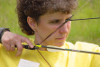 Patty using a bow and arrow during an archery demonstration June 2002