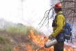 firefighter working on a controlled prescribed burn