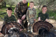 dad and kids with their two turkey during the youth turkey hunt 2015