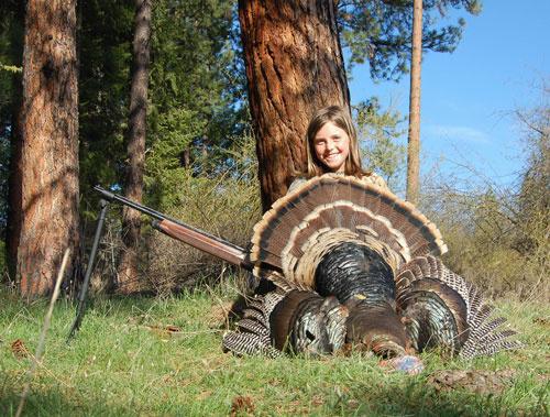Young turkey hunter with prize tom turkey / Photo by Kelton Hatch