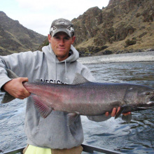 man holding a large Fall chinook