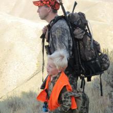 dad and Alex hunt dressed in hunter orange after taking hunter education October 2010