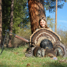 Young turkey hunter with prize tom turkey / Photo by Kelton Hatch