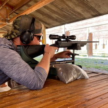 Shooter on a bench at Farragut Range