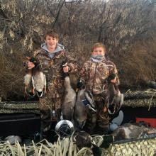 boys with their mallard ducks December 2016 vertical shot