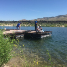 Edson Fichter Community Fishing Pond anglers fishing from a dock medium shot June 2015
