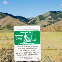 AccessYes! signage on property fence.