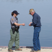 Idaho Fish and Game conservation officer Meghan Roos checks a fishing license near Castleford  March 2010