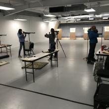 Four air gun shooters aim at targets at the Nampa Public Shooting Range
